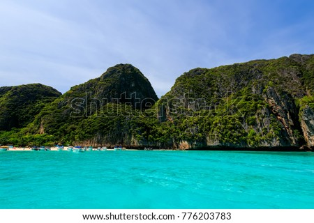 Maya Bay on the island of Phi Phi in a summer sunny day with karst rocks and turquoise sea. Landscape. Province of Krabi, Thailand. #776203783