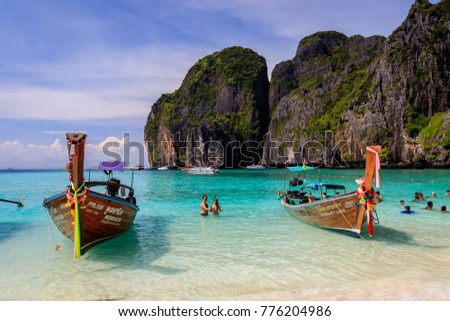 Maya Bay, Thailand, Krabi  - November 20, 2017: island of Phi Phi in a summer sunny day with karst rocks, boats, people and turquoise sea. Landscape.  #776204986