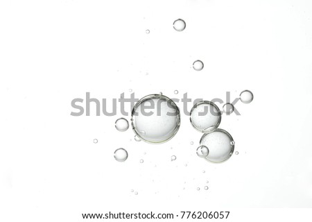 Large and clear water bubbles floats over a white background