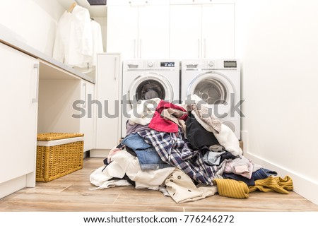 Laudry room with a pile of dirty clothes #776246272