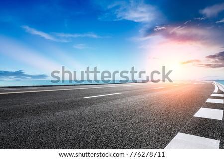 empty asphalt highway and blue sea nature landscape at sunset #776278711