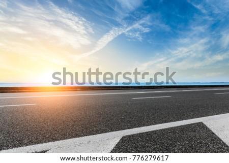empty asphalt highway and blue sea nature landscape at sunset #776279617