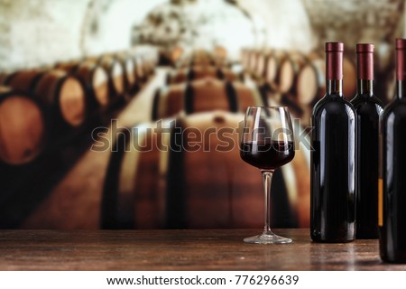 Wine cellar with wine bottle and glasses.with space for text Royalty-Free Stock Photo #776296639