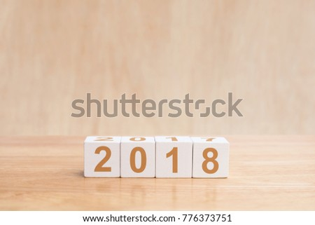 Wooden cubes with the numbers 2018 on wooden table. Merry christmas and Happy new year season with greeting card, illustration. copy space #776373751