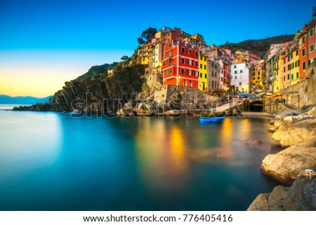 Riomaggiore town, cape and sea landscape at sunset. Seascape in Cinque Terre National Park, Liguria Italy Europe. Long Exposure #776405416