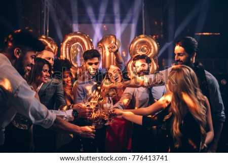 Young man pouring champagne to his friends #776413741