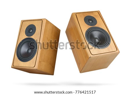 Two wooden speakers isolated on white background. File contains a path to isolation.  #776421517