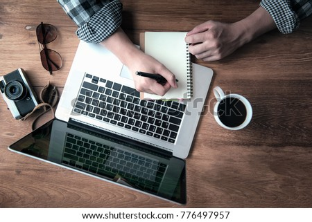 Daily Journaling with using to advantages internet technology of in doing business resulting in improved performance. Royalty-Free Stock Photo #776497957