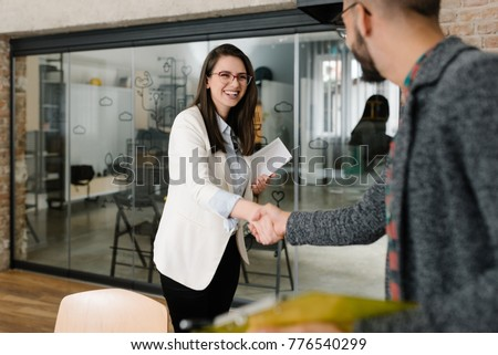 Openly greeting a job recruiter with a firm handshake #776540299