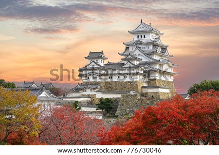 Himeji Castle and red maple leaves in evening sunlight and twilight sky in Himeji city, Hyogo prefecture of Japan. #776730046