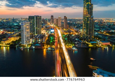 Panorama sunset colourful sky view of Bangkok cityscape with building river side view, Thailand #776764963