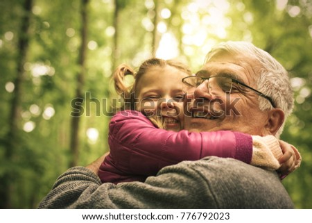 Grandfather and granddaughter talking in woods. #776792023