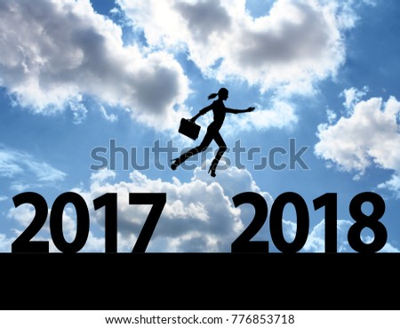 Men jump over silhouette Happy New Year 2018 #776853718