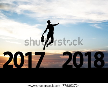Men jump over silhouette Happy New Year 2018 #776853724