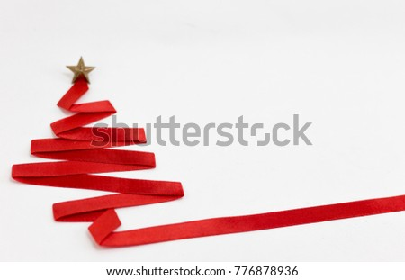 christmas tree made from ribbon on white background. christmas day concept. #776878936
