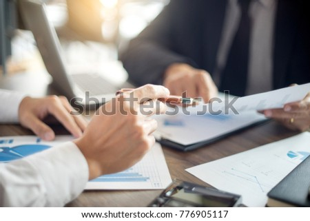 Businessman work with computer on table in office work with paper graph chart business marketing plan analysis  #776905117