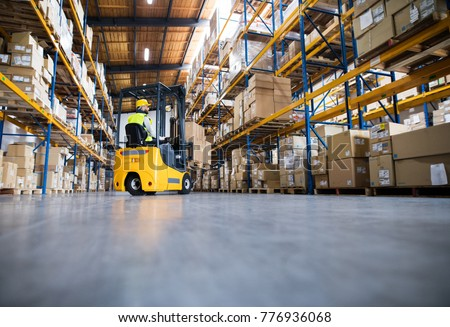 Warehouse man worker with forklift. #776936068