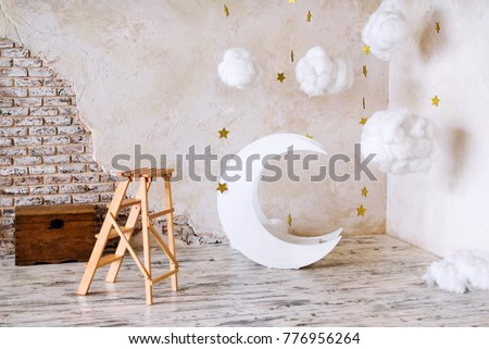 Children's location for a photo shoot. Moon with stars and clouds dreamy decor. Elements of the interior.