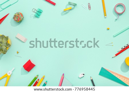 notebook, note, pen, paper clip, on pastel green background. Office desk with copy space. Flat lay. Royalty-Free Stock Photo #776958445