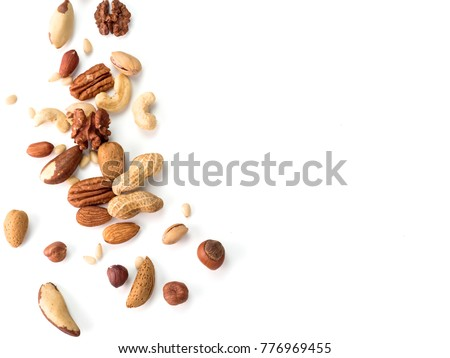Background of nuts - pecan, macadamia, walnut, almonds, hazelnuts, and other - with copy space. Isolated one edge. Top view or flat lay Royalty-Free Stock Photo #776969455