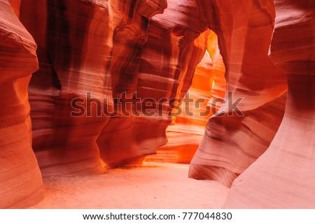 The interior of the narrow walls of the winding Antelope Canyon in Navajo Tribal Park, near  Page Arizona.  Royalty-Free Stock Photo #777044830