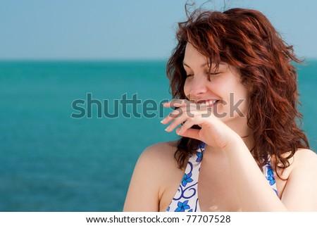 Shy Smiling Woman on a Beach #77707528