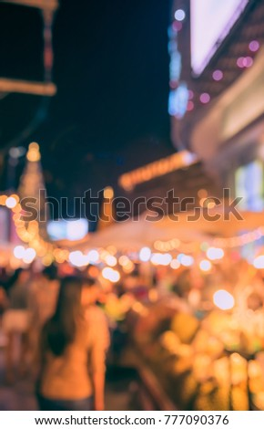 Abstract Blurred image of Night Festival on street  with light bokeh for background usage. (vintage tone) #777090376