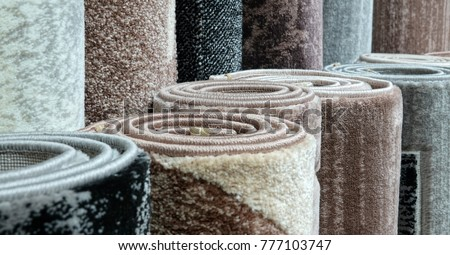 Carpets variety selection rolled up rugs shop store Royalty-Free Stock Photo #777103747