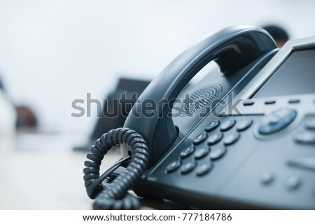 close up soft focus on telephone devices at office desk with light effect,communication technology concept Royalty-Free Stock Photo #777184786