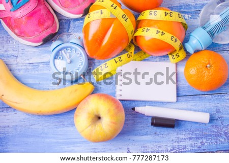 healthy lifestyle concept with fruits Blank notebook, pen. Weight loss concept #777287173
