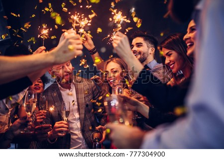 Group of friends celebrating at the nightclub #777304900