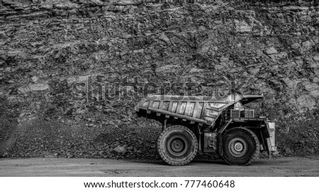 Dump truck in coal mine, black and white filter #777460648