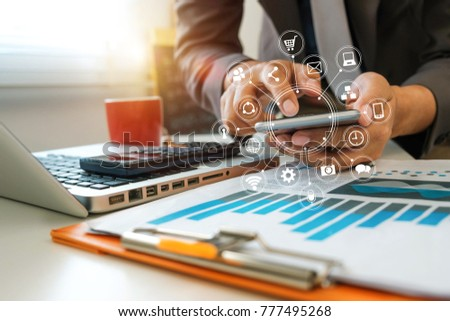 close up of businessman working with smart phone and laptop and digital tablet computer in modern office with virtual icon diagram  #777495268