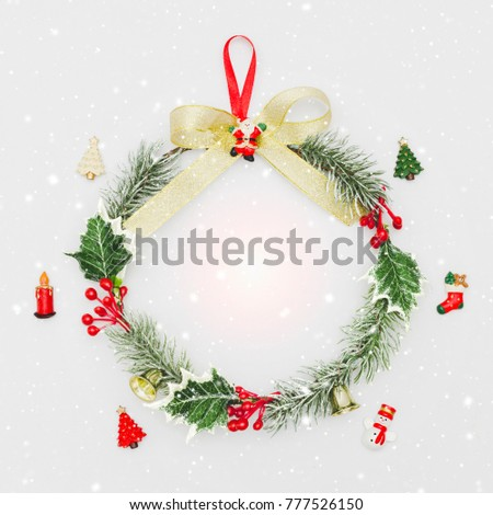 Christmas wreath and decorative ornament on white background with snow fall.Gifts and congratulations holidays concept. #777526150