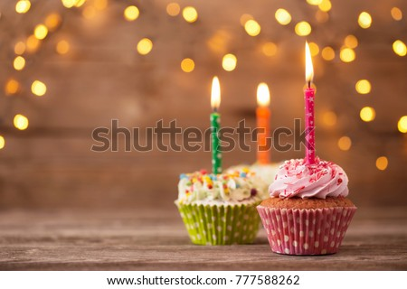 cupcakes on dark old wooden background