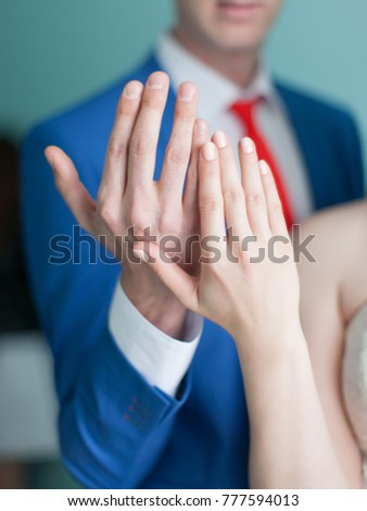 Wedding hands. Bride and groom showing their hands without wedding rings before wedding ceremony #777594013