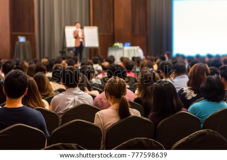 Abstract blurred photo of conference hall or seminar room with attendee background Royalty-Free Stock Photo #777598639