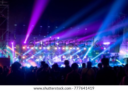 Blurred background : Bokeh lighting in outdoor concert with cheering audience #777641419