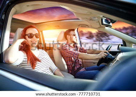 Winter trip and two lovers in car. Winter road of snow and frost with sunset time.  #777710731