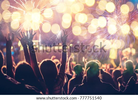 cheering crowd watching fireworks - new year concept #777751540