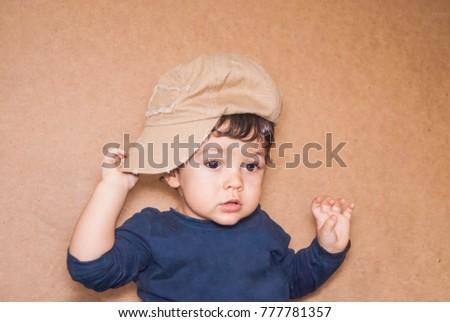cute little boy in a baseball cap #777781357