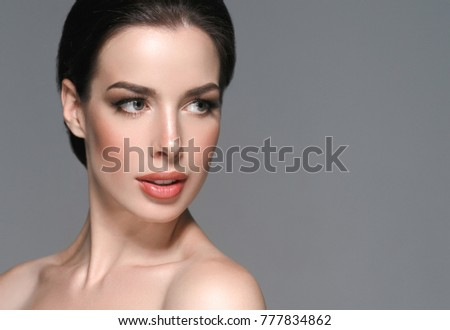 Beautiful female skin care healthy hair and skin close up face beauty portrait #777834862