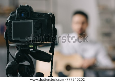 digital camera and music blogger on blurred background #777840202