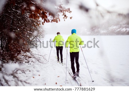 Senior couple cross-country skiing. #777881629