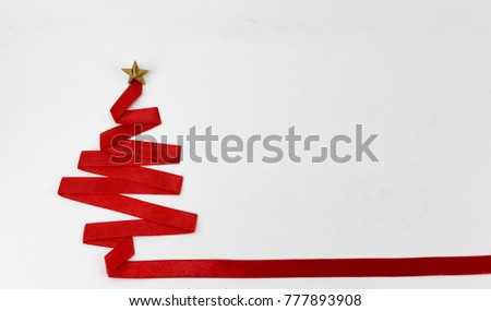 christmas tree made from ribbon on white background. christmas day concept. #777893908