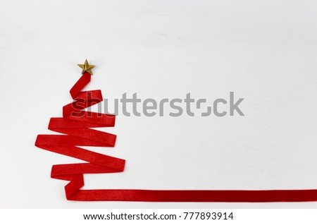 christmas tree made from ribbon on white background. christmas day concept. #777893914
