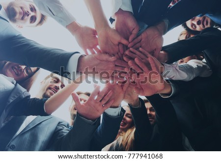 Large successfull business team showing unity with their hands t #777941068