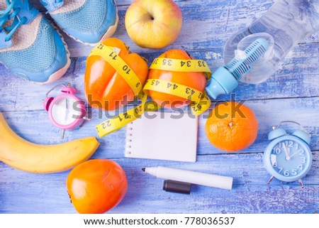 healthy lifestyle concept with fruits Blank notebook, pen. Weight loss concept #778036537