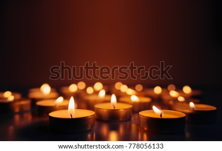 Burning candles. Shallow depth of field. Many christmas candles burning at night. Abstract candles background. Many candle flames glowing on dark background. Close-up. Free space. #778056133