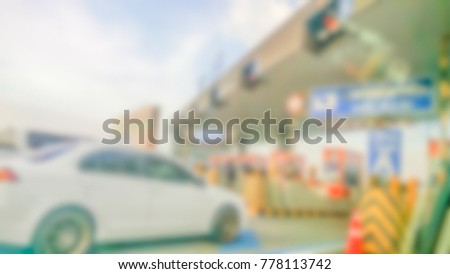 Abstract blurred traffic with cars on the road at toll road gates. Traffic concept. #778113742